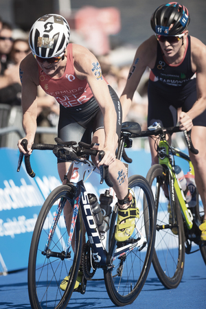 STOCKHOLM, SWEDEN - AUG 26, 2017: Leader Flora Duffy (BER) before Jessica Learmonth (GBR) at the cycling in the womens ITU triathlon series. Female Olympic distance.