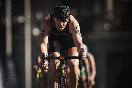 STOCKHOLM, SWEDEN - AUG 26, 2017: Closeup of Jorik Van Egdom (NED) leading a group of triathletes on bike in the ITU triathlon series for men. Olympic distance Sajtókép