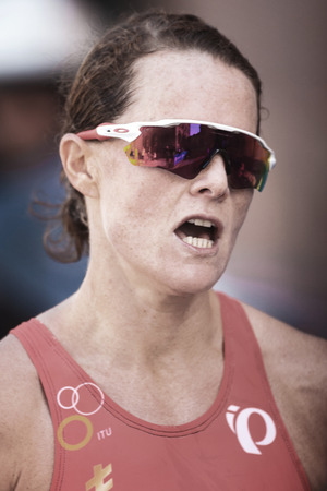 STOCKHOLM, SWEDEN - AUG 26, 2017: Closeup of the face of Flora Duffy (BER) running for victory at the womens ITU triathlon series. Female Olympic distance.