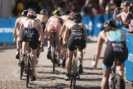 STOCKHOLM, SWEDEN - AUG 26, 2017: Chasing group cycling in the womens ITU triathlon series. Female Olympic distance.