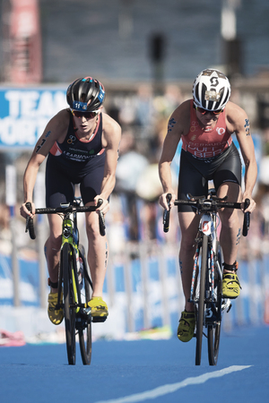 STOCKHOLM, SWEDEN - AUG 26, 2017: Leaders Flora Duffy (BER) and Jessica Learmouth (GBR) at the womens ITU triathlon series. Female Olympic distance. Editorial