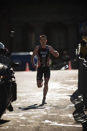 STOCKHOLM, SWEDEN - AUG 26, 2017: Jonathan Brownlee (GBR) running trough the waterstation at the ITU triathlon series for men. Olympic distance