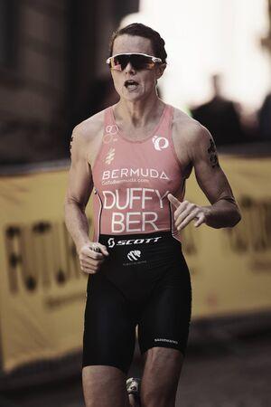 STOCKHOLM, SWEDEN - AUG 26, 2017: Flora Duffy (BER) running at the womens ITU triathlon series. Winner of the 2017 triathlon in Stockholm Editorial