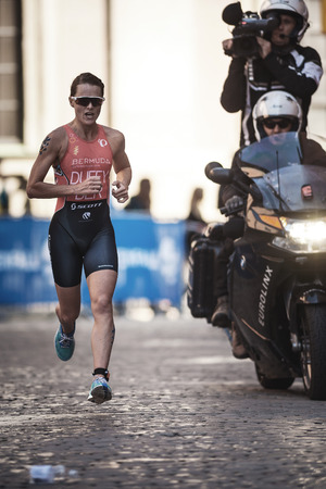 STOCKHOLM, SWEDEN - AUG 26, 2017: Flora Duffy (BER) running for victory at the womens ITU triathlon series. Female Olympic distance.