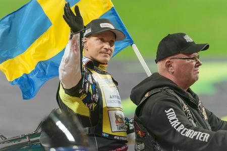 SOLNA, SWEDEN - SEPT 23, 2017: Fredrik Lindgren (SWE) enters on motorcycle bike at Stockholm FIM Speedway Grand Prix at Friends Arena in Stockholm.