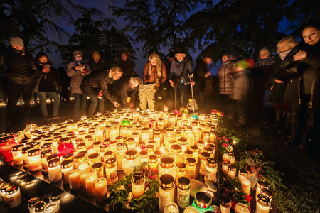 STOCKHOLM, SWEDEN - NOV 4, 2017: People mourning and remember their loved ones at the Woodland cemetary in Skogskyrkogarden during All saints night. 4 november.