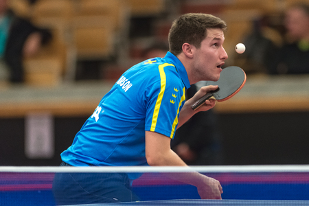 STOCKHOLM, SWEDEN - NOV 17, 2017: Kristian Karlsson (Sweden) against Feng Bo (China) at the table tennis tournament SOC at the arena Eriksdalshallen in Stockholm.
