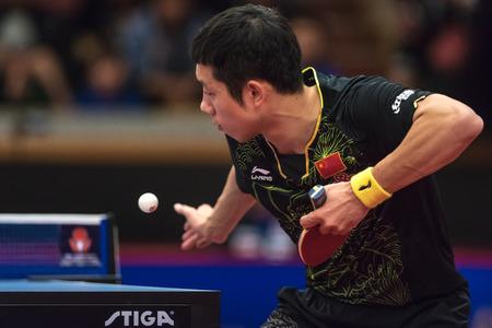 STOCKHOLM, SWEDEN - NOV 17, 2017: Xu Xin (China) against Tomokazu Harimoto (Japan) at the table tennis tournament SOC at the arena Eriksdalshallen in Stockholm. Editorial
