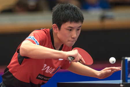 STOCKHOLM, SWEDEN - NOV 17, 2017: Tomokazu Harimoto (Japan) against Xu Xin (China) at the table tennis tournament SOC at the arena Eriksdalshallen in Stockholm.