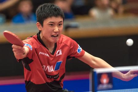 STOCKHOLM, SWEDEN - NOV 17, 2017: Tomokazu Harimoto (Japan) against Xu Xin (China) at the table tennis tournament SOC at the arena Eriksdalshallen in Stockholm.