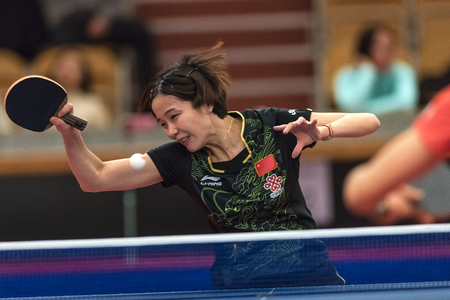 STOCKHOLM, SWEDEN - NOV 17, 2017: Zhang Qiang (China) against Ding Ning (China) at the table tennis tournament SOC at the arena Eriksdalshallen in Stockholm.