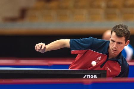 STOCKHOLM, SWEDEN - NOV 17, 2017: Jonathan Groth (Denmark) against Kenta Matsudaira (Japan) at the table tennis tournament SOC at the arena Eriksdalshallen in Stockholm. Editorial
