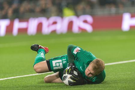 STOCKHOLM, SWEDEN, MARCH, 12, 2018 Hacken goalkeeper Peter Abrahamsson saving at the Swedish cup quarterfinals between Djurgarden and Hacken. Winner DIF with 1-0