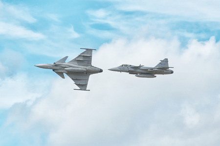 UPPSALA, SWEDEN, 25 AUG, 2018: Two Swedish military airforce JAS Gripen captured from both below and side