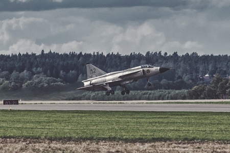 UPPSALA, SWEDEN, 25 AUG, 2018: Viggen JA-37 takeoff during the airshow in Uppsala. This retired swedish aircraft was built by SAAB.