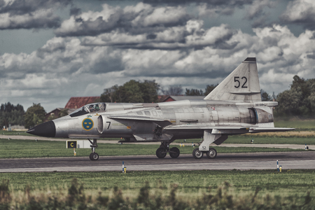 UPPSALA, SWEDEN, 25 AUG, 2018: Viggen JA-37 taxing on runway during the airshow in Uppsala. This retired swedish aircraft was built by SAAB. 報道画像