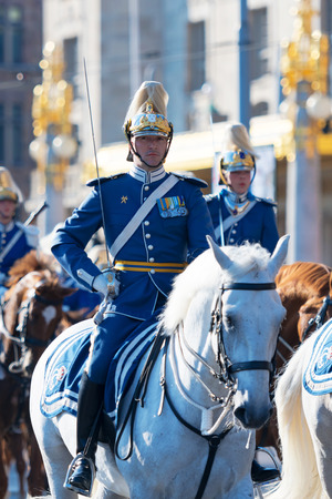STOCKHOLM, SWEDEN - JUNE 6, 2019: Mounted guards before the Royal carriages during the national day of Sweden, June 6th.