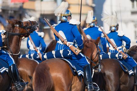 STOCKHOLM, SWEDEN - JUNE 6, 2019: Mounted royal guards behinde the Royal cortege during the national day of Sweden, June 6th.