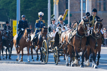 STOCKHOLM, SWEDEN - JUNE 6, 2019: The carriage with the Queen Silvia and Princess Sofia waving their hands at Royal cortege during the national day of Sweden, June 6th. Redactioneel