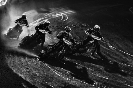 HALLSTAVIK, SWEDEN, JULY 6, 2019: Speedway racers in black and white at the Speedway GP in Hallstavik in the HZ Bygg Arena.