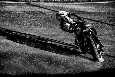 HALLSTAVIK, SWEDEN, JULY 6, 2019: Maciej Janowski (POL) into a curve at the Speedway GP in Hallstavik and HZ Bygg Arena. Black and white Sajtókép