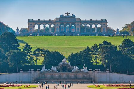 VIENNA, AUSTRIA: The Gloriette on the hill above the Schoenbrunn palace park complex during a hazy sunny day. Stock Photo