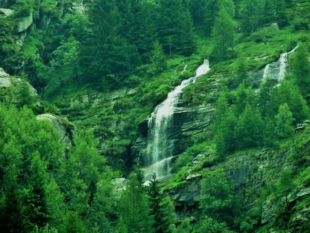 Waterfall in green Mountains. Stock Photo