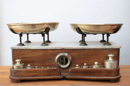 antique weight scale: Antique scale with brass pans and weights and a wood and marble base