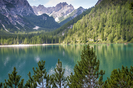 Carezza Lake in Trentino Alto Adige, Italy. Lake in the Alps with wonderful colors. the dense forests of firs and the mountains are reflected in its crystalline waters
