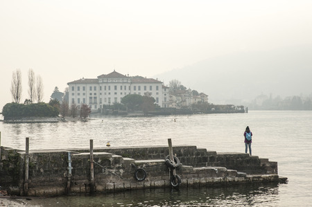Lake Maggiore, Italy. On a winter day the island in the middle of the lake is blurred by fog