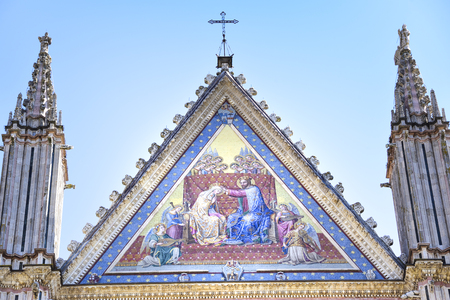 Detail of the facade of the cathedral of Orvieto, Umbria, Italy. Mosaic depicting the coronation of the virgin Mary