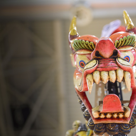 Traditional red dragon mask of Asian peoples