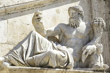 Rome, Italy ,Campidoglio square sculpture depicting the Tiber river. In detail Romulus and Remus Banco de Imagens