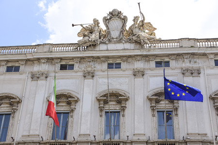Rome, Italy, the Consulta building in Quirinale square. At the top are Justice and Religion