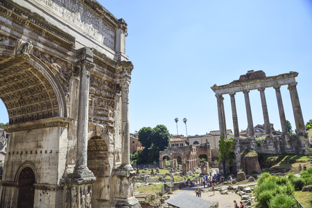 Rome, Italy, ruins of the Imperial forums of ancient Rome. Arch of Septimius Severus and Temple of Saturn