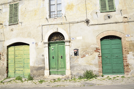 Italy, old town, characteristic green gates of an ancient building