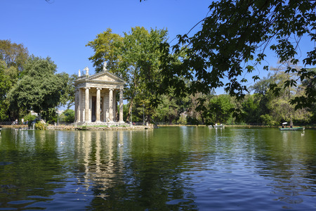 Garden of Villa Borghese. Lake with boats and temple of Esculapio.Rome Italy 報道画像