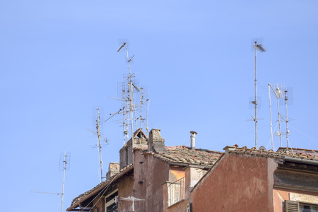 Antennas on the roofs of Rome Stock Photo