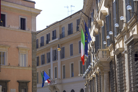 views of Rome with flags from Italy and the European community.