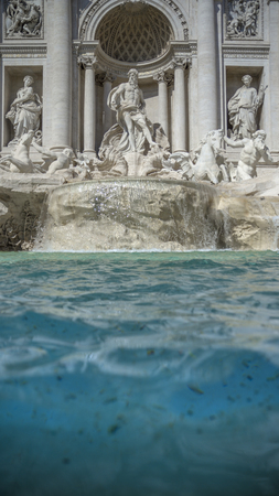 The Trevi Fountain. In the foreground coins that tourists throw into the fountain. Rome Italy