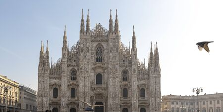 Milan, Italy. View of the Milan Cathedral with a flying bird