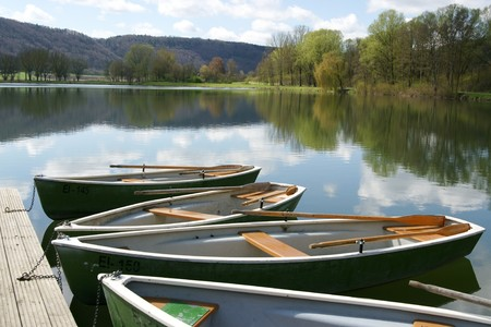 Boats in front of scenic landscape Stock Photo