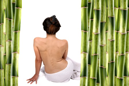 nudist young: woman surrounded by bamboo shoots and water with reflexion