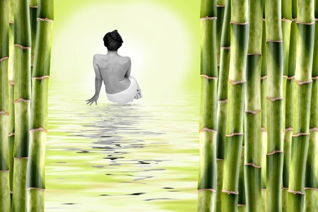 woman surrounded by bamboo shoots and water with reflexion Stock Photo - 4102510