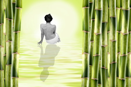 woman surrounded by bamboo shoots and water with reflexion Stock Photo - 4102503