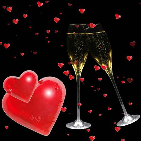 Valentine hearts with champagne flutes on black background photo