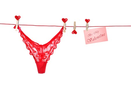 anniversary sexy: Fancy red G-String hanging from Clothes-Line with white background