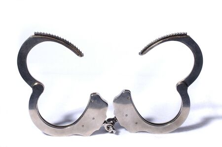 Modern open Handcuffs isolated over white background Stock Photo - 4123678