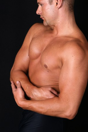bare shoulders: muscles of a bodybuilder