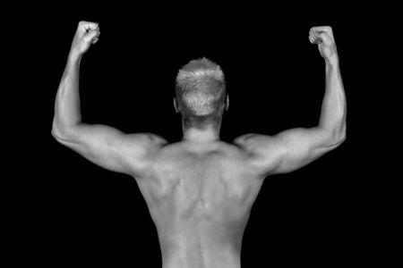 Muscular Back of a Bodybuilder over Black photo